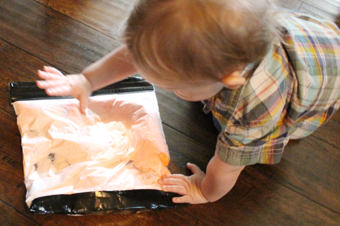 toddler playing with sensory bag