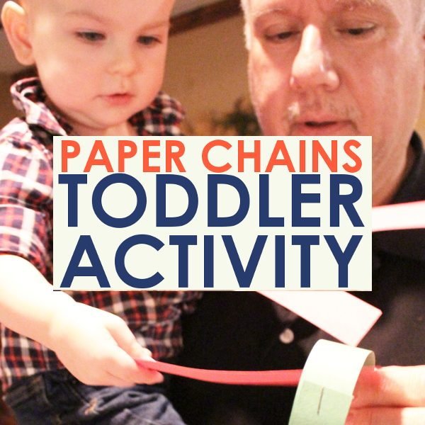 toddler activity rainy day promo image of grandpa making paper chains with his toddler grandson