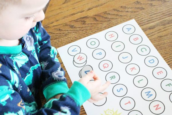 3 year old playing an alphabet matching game