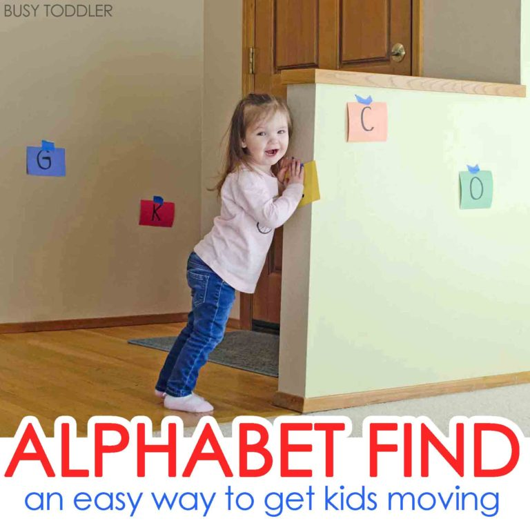 young girl ready to find hidden letters during alphabet game