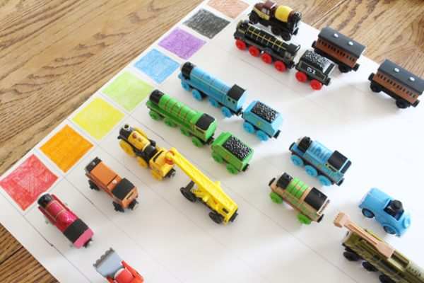 Trains sorted onto color graphing activity