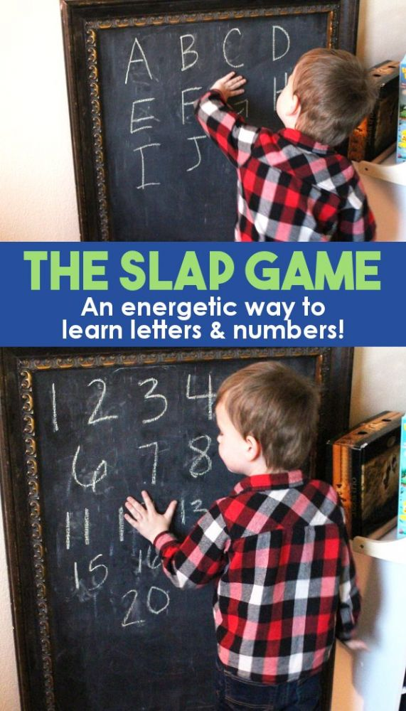 young boy learning letters and numbers on a chalkboard