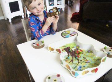 4 year old boy playing preschool board game