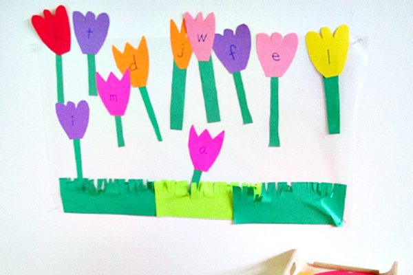 wall of construction paper alphabet flowers