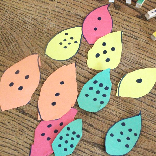 Colorful leaves with black dots for fall math game
