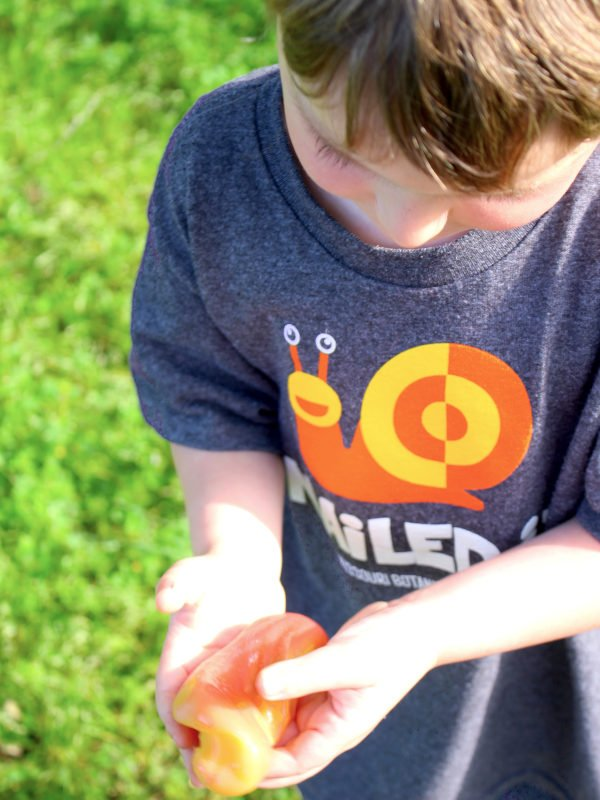 child engaging in sensory play with simple slime recipe that changes colors