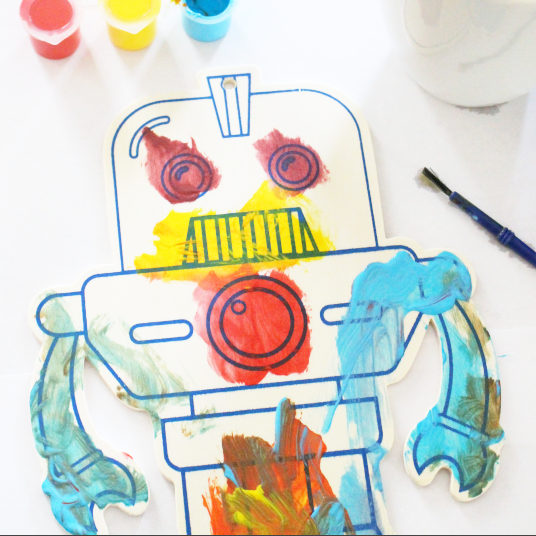 robot creatively painted by kid with tempera paint