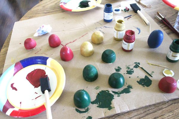 various colors of drying eggs from wooden Easter eggs painting activity