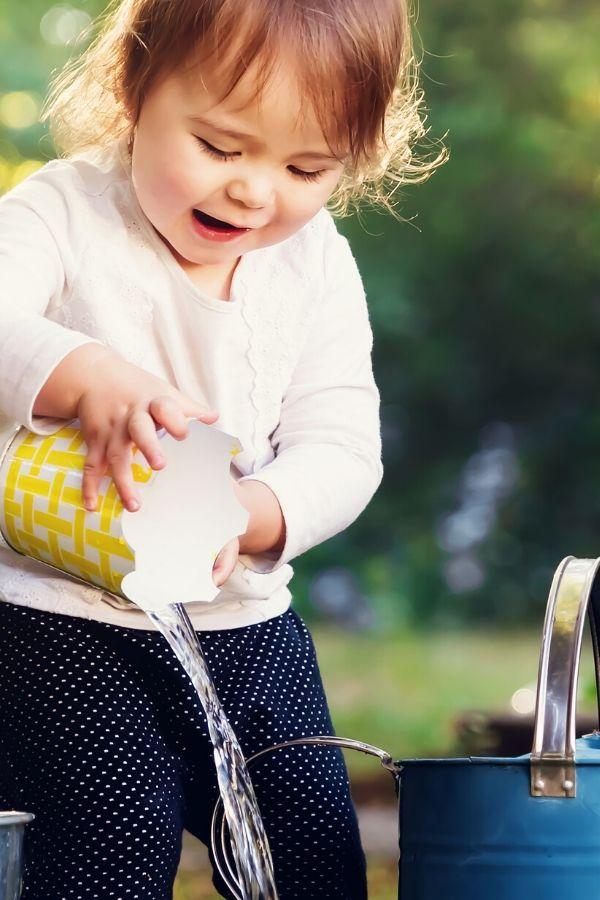 preschooler engaging in water play activity for preschoolers and big kids