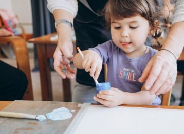 mother and child painting in homeschool class