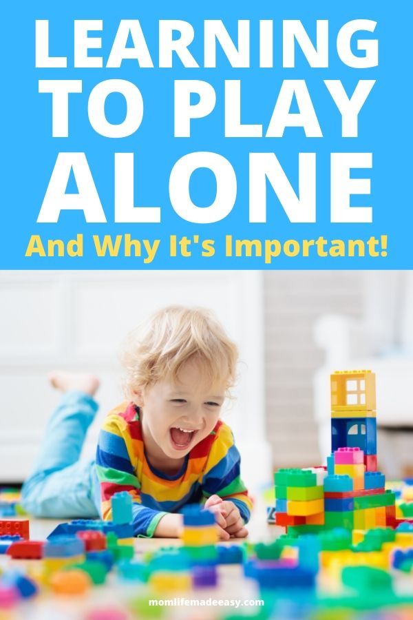 child playing alone with LEGO Duplo bricks