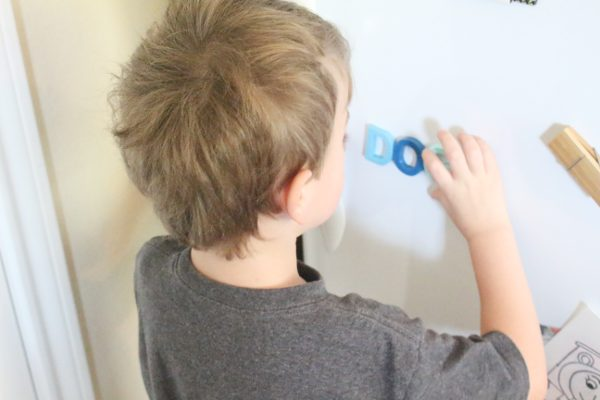 preschool student placing letters in alphabet activity
