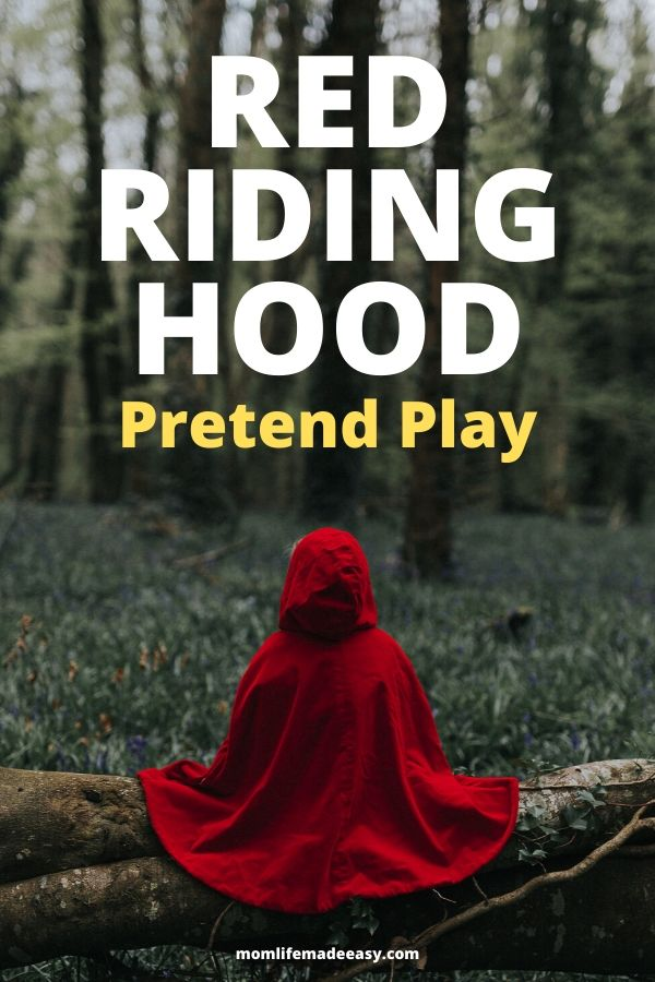child wearing red riding hood for little red riding hood pretend play