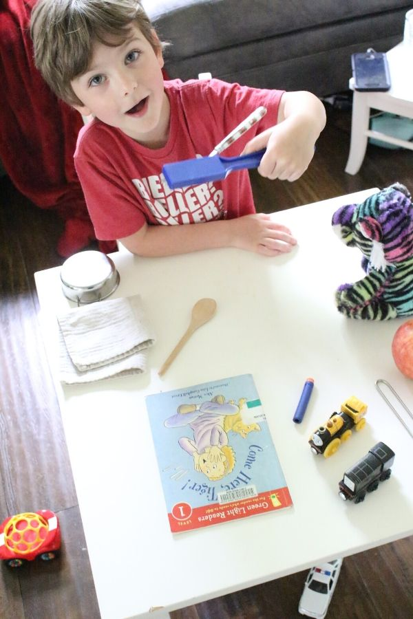 child using magnet wand for STEM activity