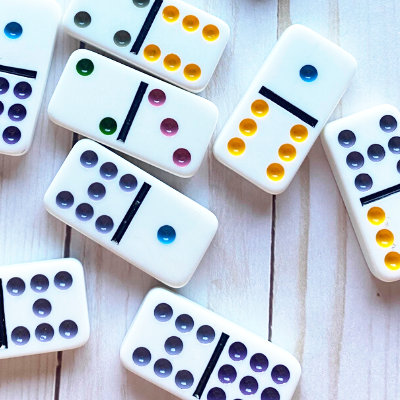 dominoes in a pile ready to be used in fun math worksheets