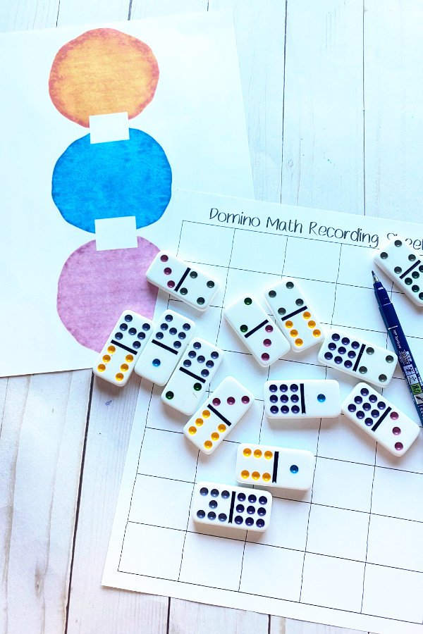 two domino fun math worksheets printed out with dominoes on top of them