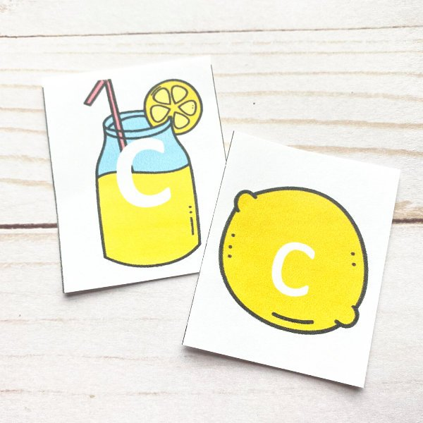 "lemonade glass and lemon with ""c"" demonstrating a match in the letter matching game"