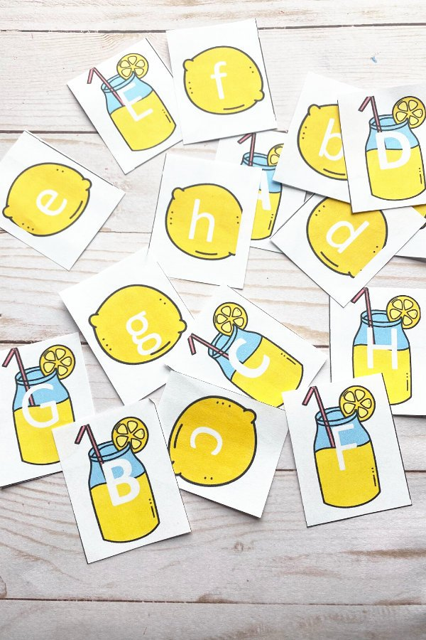 letter matching game cards spread out all over table