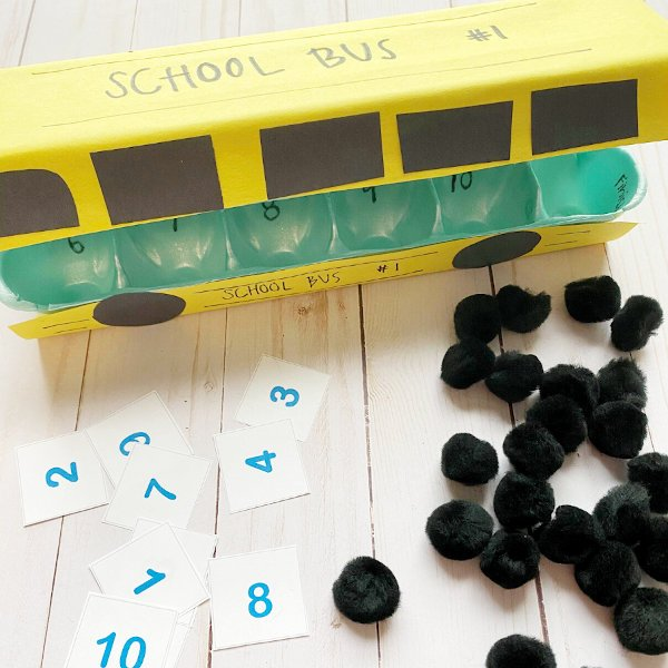 cool math game for preschool math activity that looks a school bus displayed on a white table