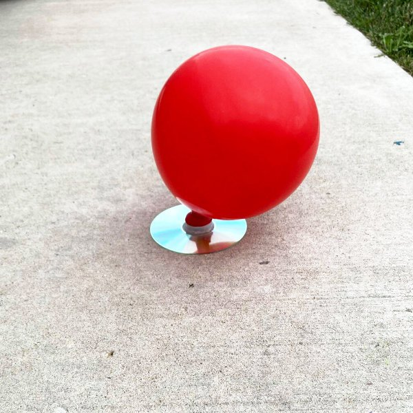 an inflated balloon hovercraft project for kids made with recycled materials