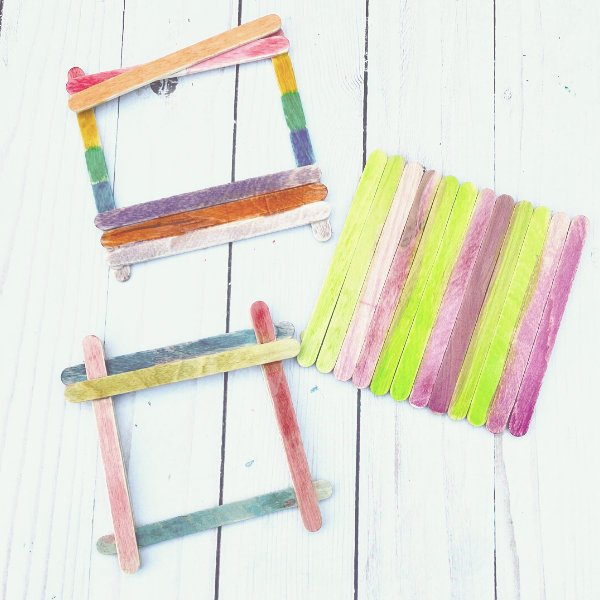 some popsicle stick picture frames in a variety of colors, ready to be filled with pictures!