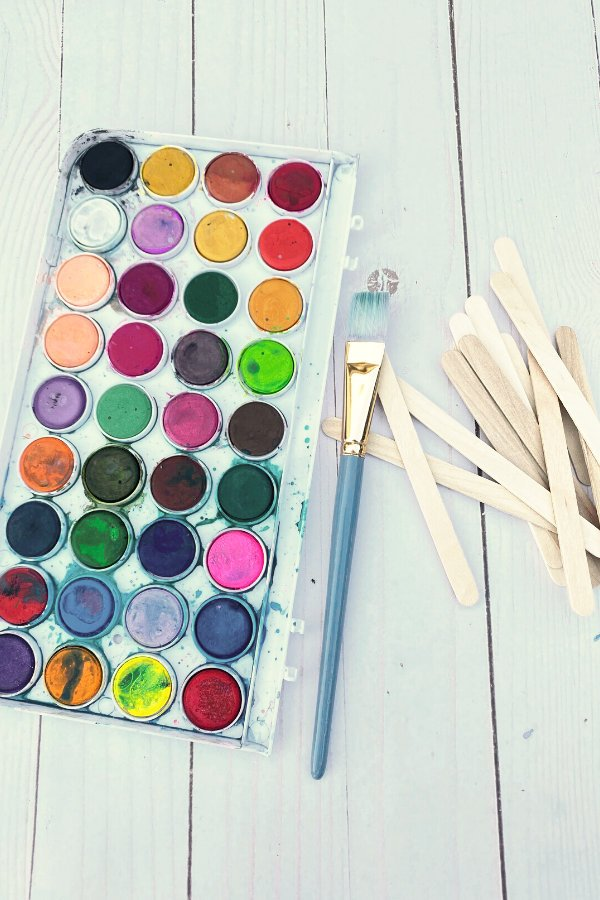 supplies for making popsicles stick picture frames include popsicle sticks as well as paints to decorate them with