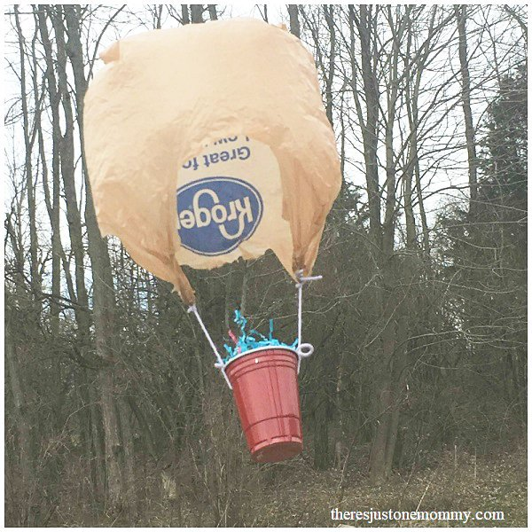 flying egg in a basket with grocery bag parachute for egg drop STEM challenge science experiment for kids at home