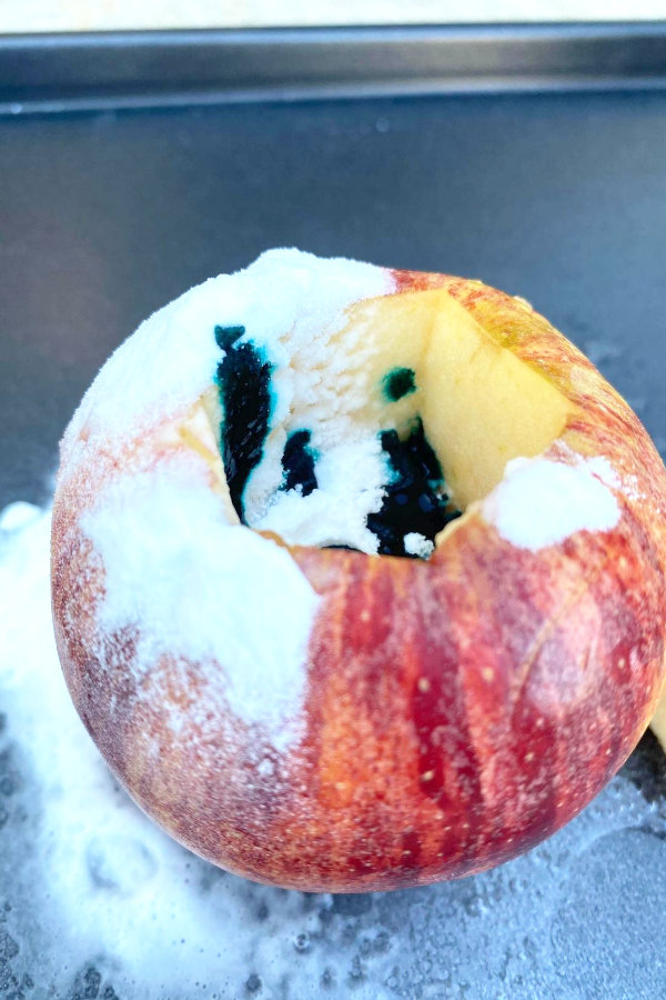 baking soda and food coloring inside an apple for the very simple volcano science experiment