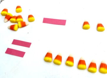 cute candy corn math activity in action with an 8-2=6 math problem