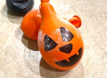 An orange DIY stress ball made to look like a pumpkin