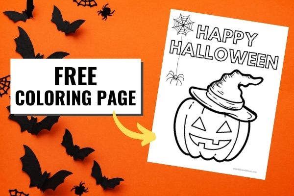 Bats flying around a printed version of the happy halloween coloring page