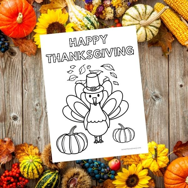 happy thanksgiving coloring page on a wooden fall themed background