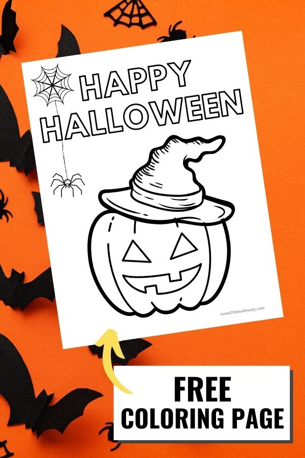 Bats flying on a orange background around a printed version of the happy halloween coloring page