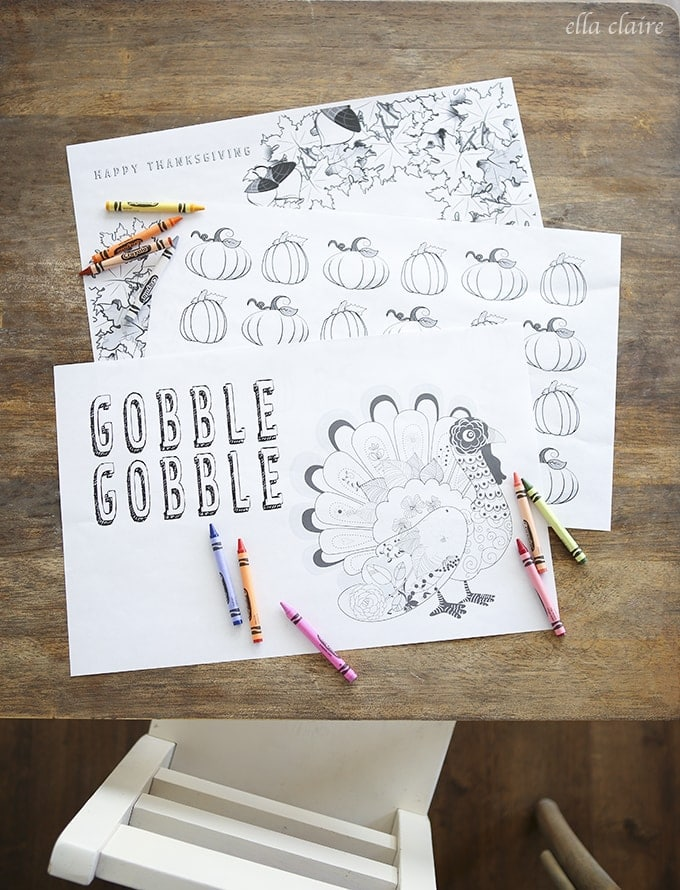 thanksgiving fall themed printable placemat coloring pages arranged on a table