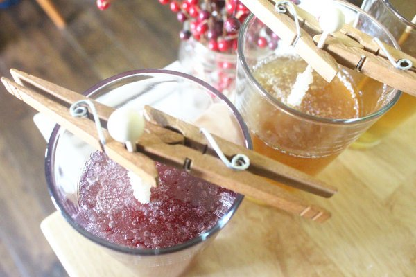 when making rock candy, these sticks are suspended by clothespins to keep them from falling into the glass