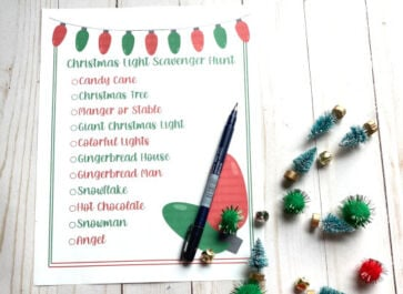 Christmas light scavenger hunt printed out with jingle bells and Christmas trees