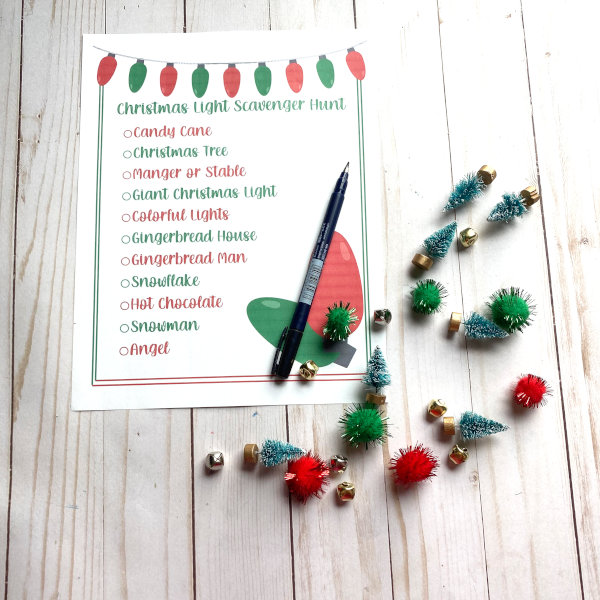 Christmas light scavenger hunt printed out with pompoms and mini Christmas trees