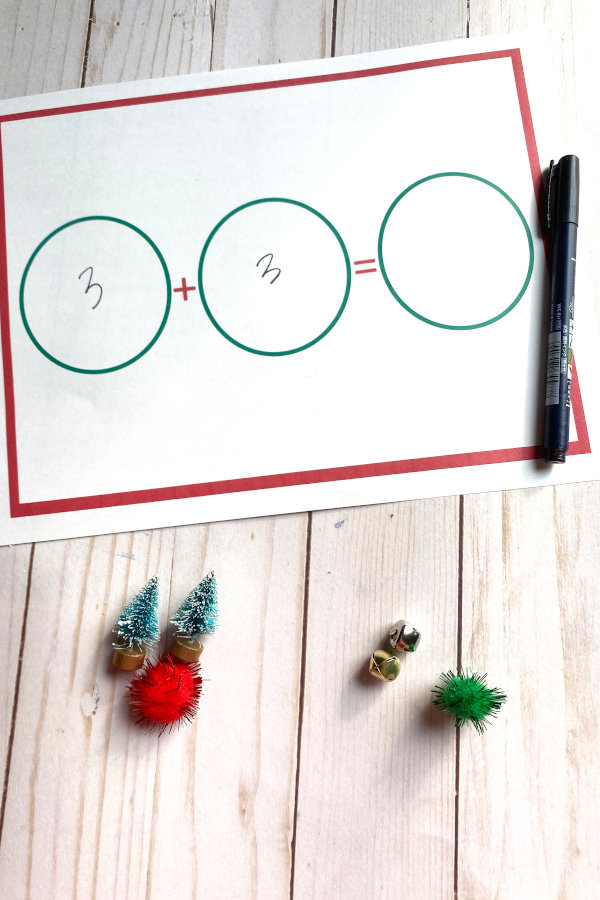 Christmas math worksheet and manipulatives demonstrating how to solve 3+3