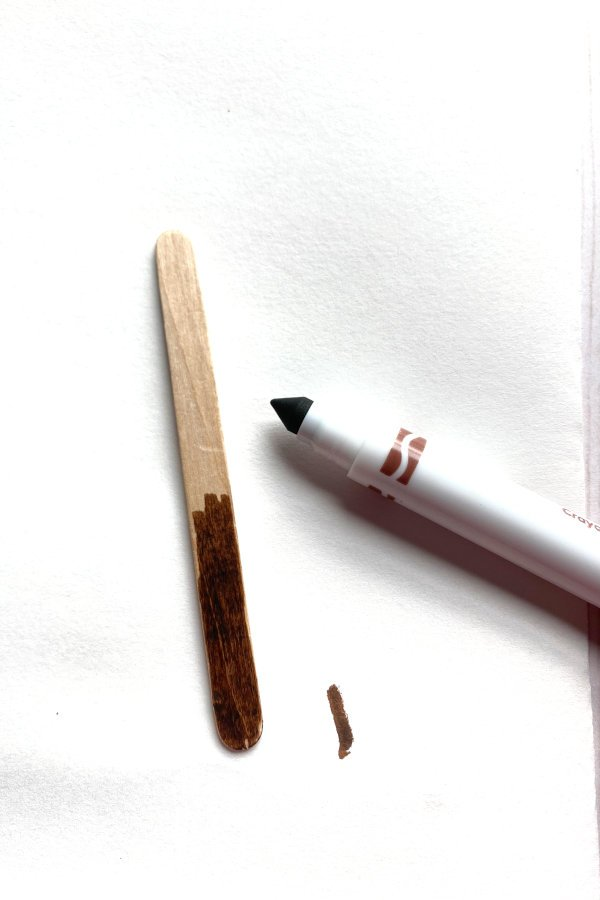 brown marker coloring a popsicle stick