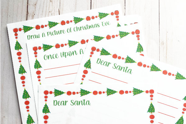 blank printable santa letter pack printed out and displayed on a table