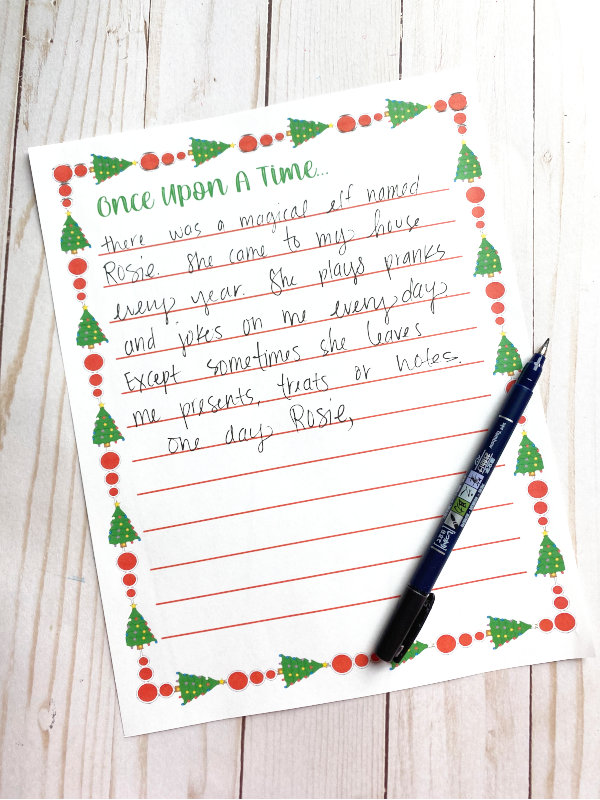 a printed copy of the once upon a time printable displayed with a handwritten Christmas story on it