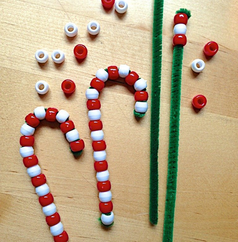 these red and white bead and pipe cleaner easy christmas crafts are fun, cute, and perfect for trimming the tree!