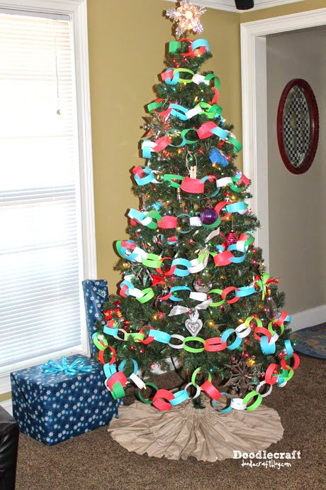 paper chains wrapped around a christmas tree as a decoration