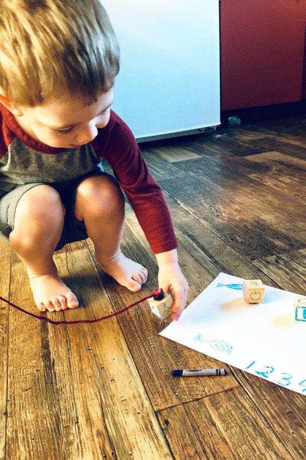 preschool student playing with fishing rod preschool math game