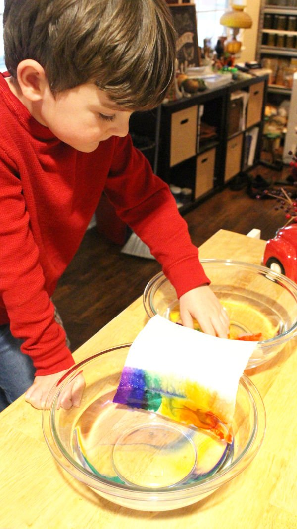 student performing capillary action stem activity for kids