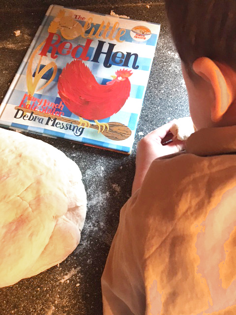 the little red hen and some tasty bread dough with a preschool child
