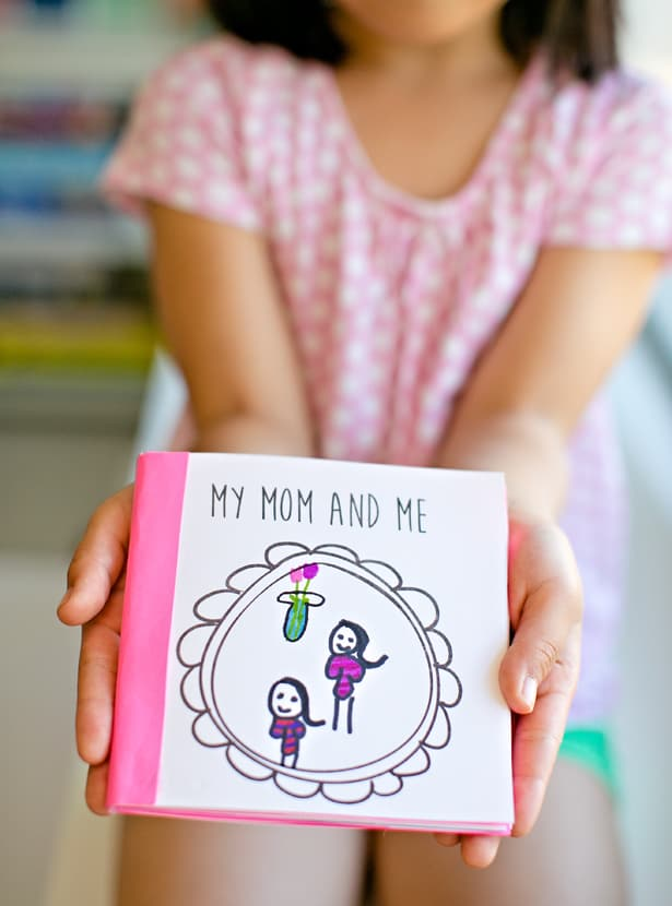 Cute mommy and me book being held out by a young child