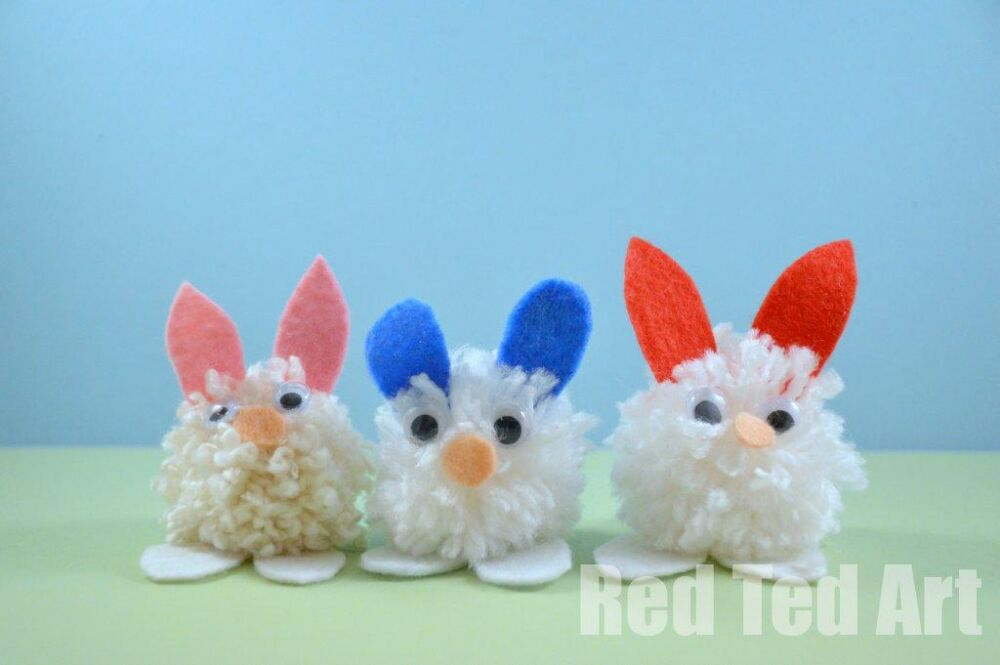these are some seriously sweet little easter bunny pom moms arranged together