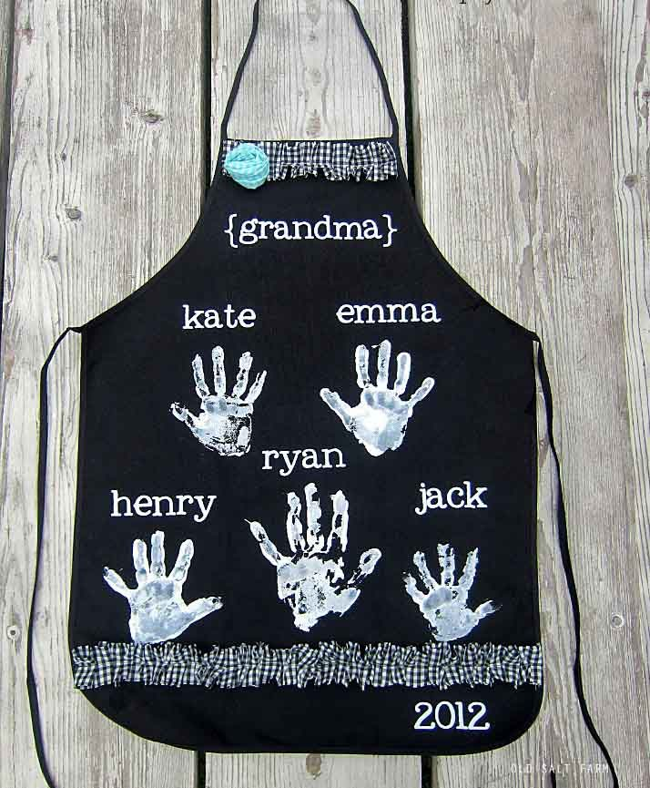Mother's Day Craft Idea handprint apron personalized with names of children or grandchildren. This is a black apron with white paint