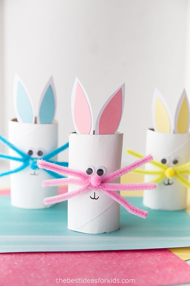 toilet paper roll bunny easter arts and crafts idea displayed on a table with a blue tablecloth